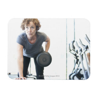 Baby boomer woman working out triceps in health magnet