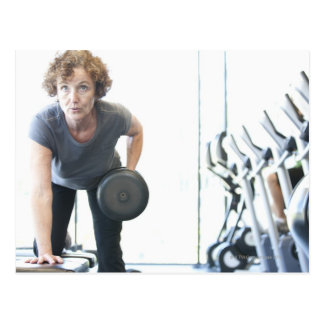 Baby boomer woman working out triceps in health post card