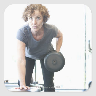 Baby boomer woman working out triceps in health square sticker