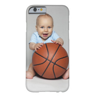 Baby boy (6-9 months) holding basketball, barely there iPhone 6 case