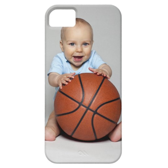 Baby boy (6-9 months) holding basketball, iPhone SE/5/5s case