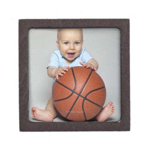 Baby boy (6-9 months) holding basketball, premium trinket boxes