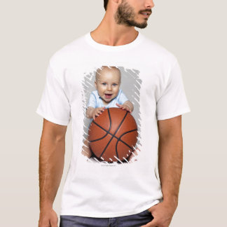 Baby boy (6-9 months) holding basketball, T-Shirt
