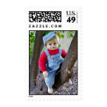 BABY BOY DOLL IN TREE POSTAGE