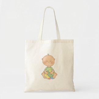 baby boy holding easter egg budget tote bag