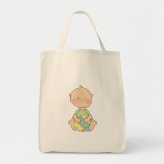 baby boy holding easter egg grocery tote bag