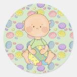 baby boy holding easter egg sticker