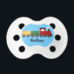 "Baby Boy Personalized Blue Train Pacifier<br><div class=""desc"">This cute pacifier features a red,  green and yellow train on an aqua blue  background and the name of your choice.</div>"