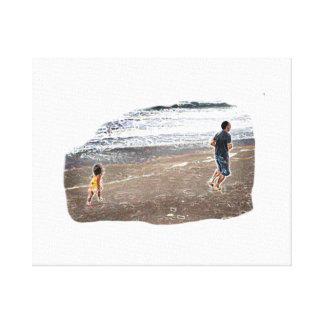 Baby Chasing Man on Beach Art Canvas Print