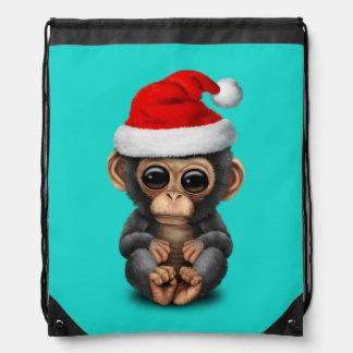 Baby Chimp Wearing a Santa Hat Drawstring Bag