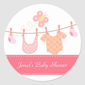 Baby clothes hanging on clothesline with butterfly round sticker