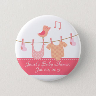 Baby clothes hanging on clothesline with pink bird pinback button