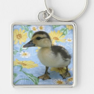baby duckling on flowered background left key chain
