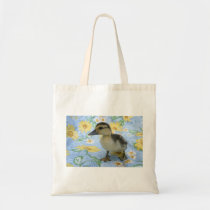 baby duckling on flowered background left tote bag
