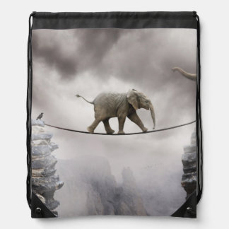 Baby elephant walks tightrope across big gorge. drawstring backpack