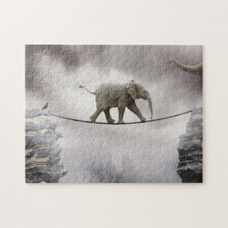 Baby elephant walks tightrope across big gorge. jigsaw puzzle
