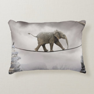 Baby elephant walks tightrope across big gorge. accent pillow