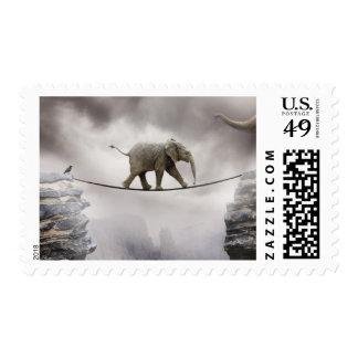 Baby elephant walks tightrope across big gorge. postage