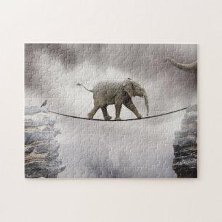 Baby elephant walks tightrope across big gorge. puzzle