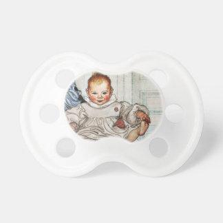 Baby Esbjorn Pulls on His Foot Pacifier