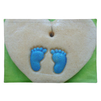 baby feet in blue cloth placemat