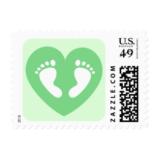 Baby feet in green heart baby shower postage stamp
