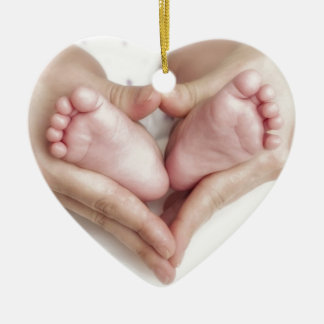 Baby feet in mother hands ornament