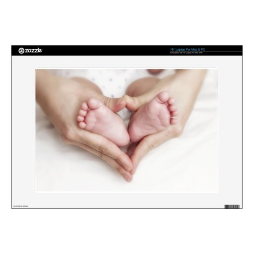 Baby feet in mother hands skins for laptops