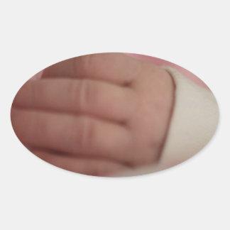 Baby fingers oval sticker