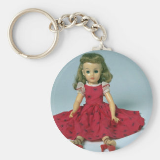 Baby girl doll dressed in red keychain