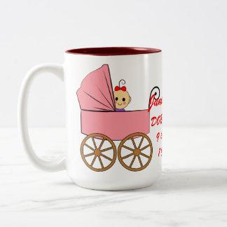 baby girl in a stroller Two-Tone coffee mug