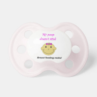 Baby girl pink pacifier breast feeding rocks