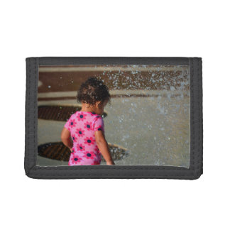 baby in pink  in fountain trifold wallet