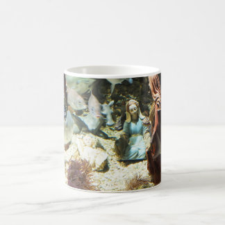 Baby Jesus in an underwater nativity Coffee Mug