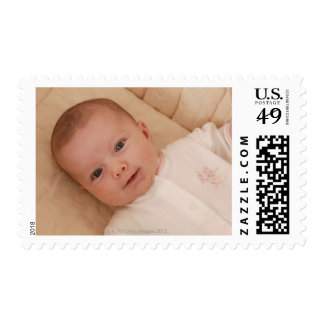 Baby lying down postage
