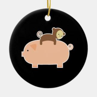 Baby Monkey Riding Backwards on a Pig Ceramic Ornament