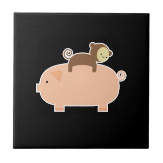 Baby Monkey Riding Backwards on a Pig Tile