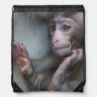 Baby monkey staring. cinch bag