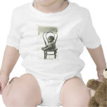 Baby on a chair t shirts