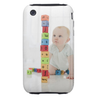 Baby on floor looking at stacked wood blocks tough iPhone 3 case