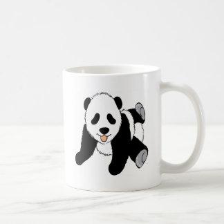 Baby panda cub playing coffee mug