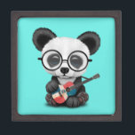 "Baby Panda Playing Dominican Flag Guitar Jewelry Box<br><div class=""desc"">This adorable design features a baby panda bear playing a guitar painted with the flag of Dominican Republic. The small panda is wearing large eye glasses which give it a nerdy, hipster feel. The old acoustic guitar is covered in nicks and scratches making it look like a well-used instrument. This...</div>"