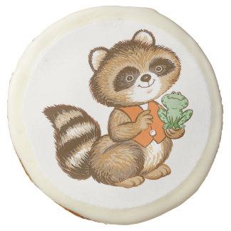 Baby Raccoon in Orange Vest with Green Frog Friend Sugar Cookie