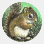 Baby squirrel and cones sticker