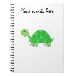 Baby turtle in green fade notebook