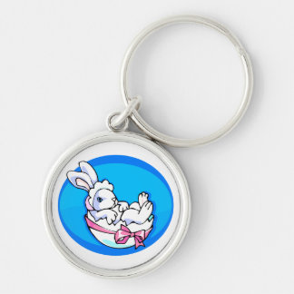 baby white bunny in egg blue oval.png keychain