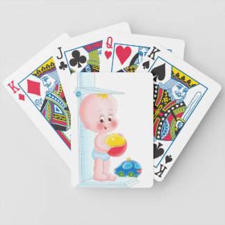 baby with toys bicycle playing cards