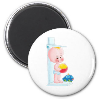 baby with toys refrigerator magnets
