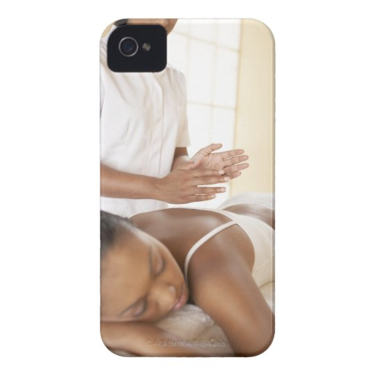 Back massage. Woman receiving a back massage by Case-Mate iPhone 4 Case