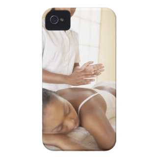 Back massage. Woman receiving a back massage by iPhone 4 Cover